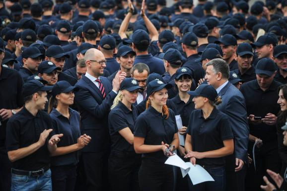 Members of the new Ukrainian police members swear at their oath-swearing ceremony in Kyiv