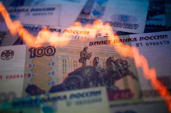Курс долара вРосії перевищив 70 рублів через обвал цін нанафту