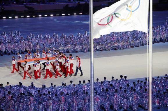 Белый флаг над Москвой. Почему выступления под олимпийскими знаменами — это старая российская традиция