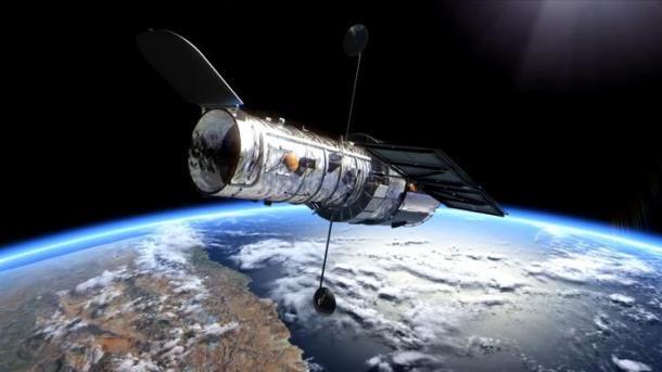"""Телескоп """"Хаббл"""" начал новую миссию: искать старые галактики и темную материю"""