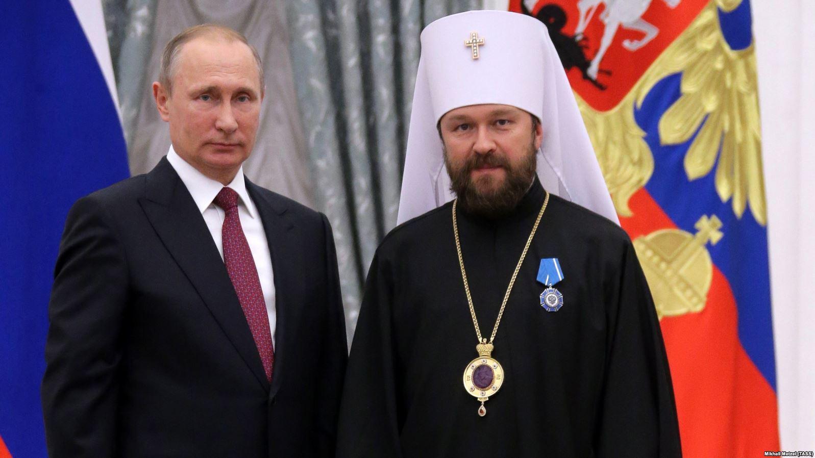 Илларион с Путиным